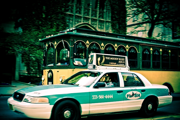 A trolley and cab on Delaware in Chicago.. I was riding along with the band Doxi to their show and could not help taking photos on the way.
