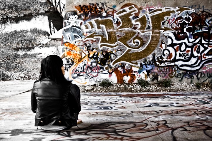 I don't have anything very recent to post today so I was looking back through some photos and found this one of my friend sitting under a bridge admiring the graffiti all over the pillars.  Enjoy your weekend!