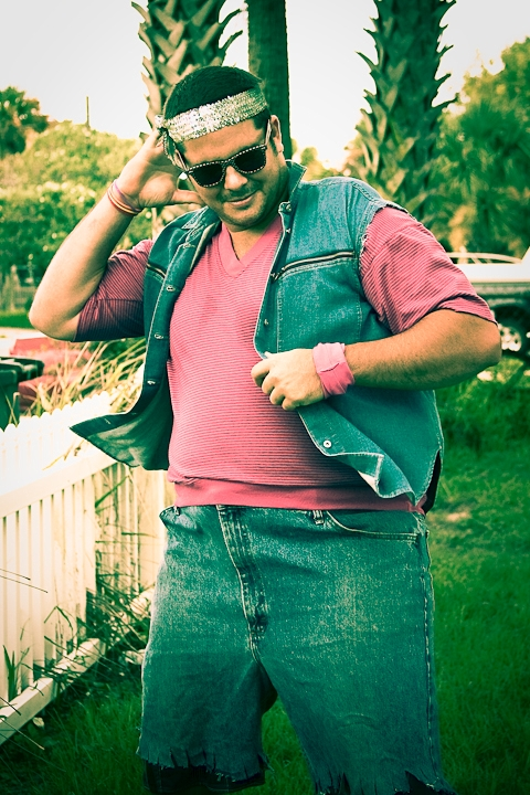 This is a recent photo of a friend getting ready to go to an 80s theme party.. His outfit was so funny I just had to photograph it.