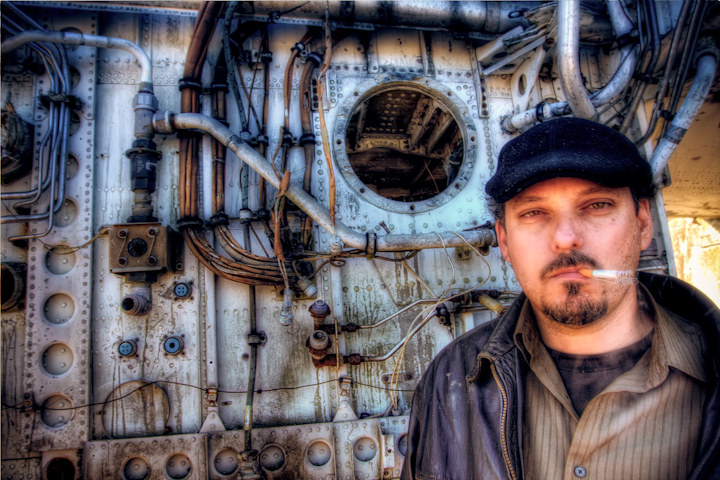 Well its been a long time since I have updated the photoblog.  Many things have been going on keeping me from this..  I will have lots of new updates coming regularly again soon hopefully.  In the mean time here is an HDR portrait I made of a fellow photographer while we exploring a plane graveyard in St. Augustine, Florida.