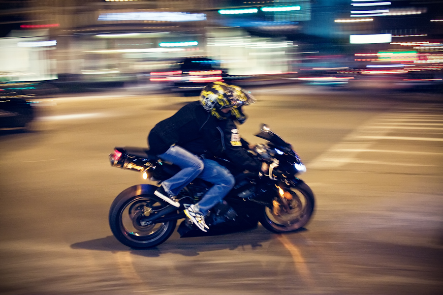 I made this photo the other night in downtown Chicago after I met with the mad photographer Jez Coulson [1]. He has a love for blurring cabs and I had caught this by luck when I noticed this motorcycle come around the corner.  On a side note welcome to the new website. There will be some slight changes over the coming weeks, but I encourage YOU to please comment and suggest new ideas.  [1] http://www.jezblog.com
